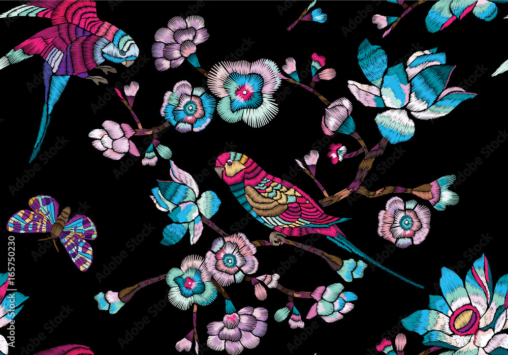 Seamless pattern with flowering branch and bird on a black background. Vector Illustration for embroidery, patches and textile.