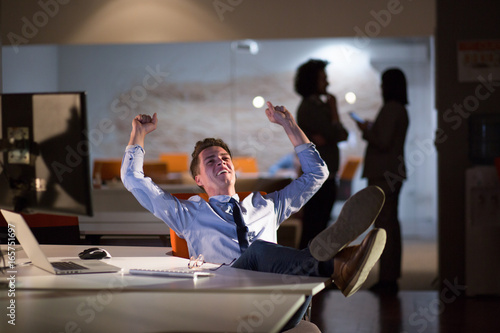 Fototapety, obrazy: businessman sitting with legs on desk at office