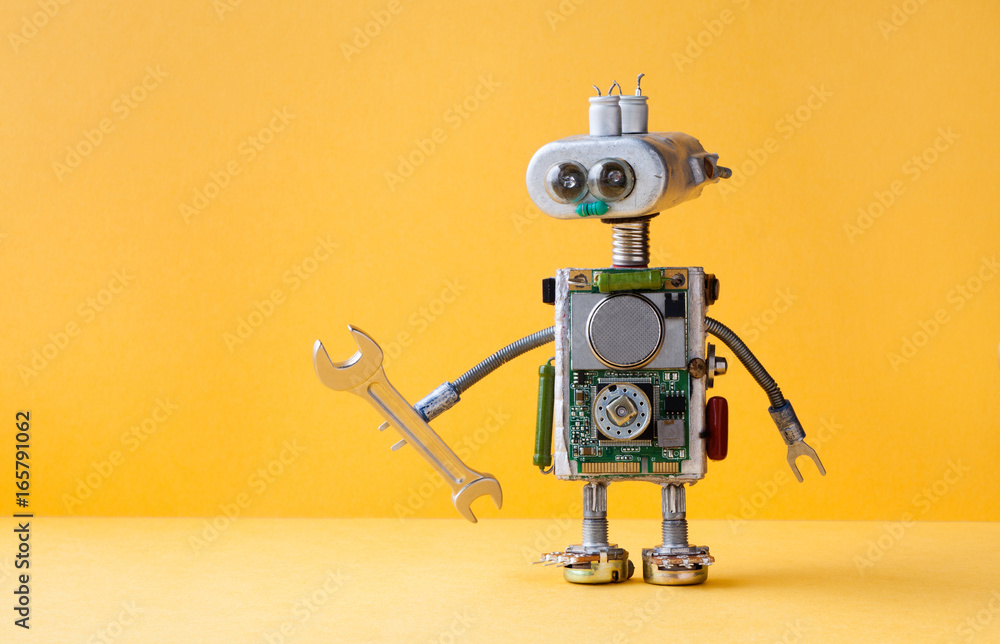 Fototapety, obrazy: Hand wrench robot serviceman worker on yellow background. Cyborg toy lamp bulb eyes head, electric wires, capacitors vintage resistors.