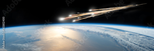 Obraz na plátne  A meteor streaks towards a collision with Earth as it breaks up over the ocean