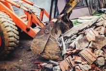 Bulldozer Demolishing Concrete Brick Walls Of Small Building And Gathering Debri, Loading Into Dumper Trucks