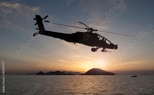 Poster Helicopter attack helicopter on the sun set