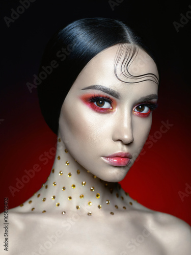 Valokuva  Woman with bright red makeup