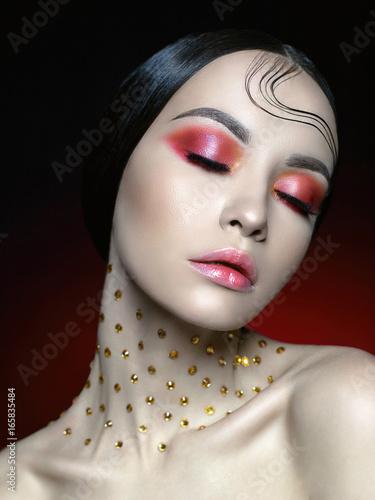 Obraz na plátně Woman with bright red makeup