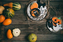 Squash And Halloween Cookies On Wooden Table