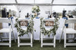 canvas print picture - Wedding table under tent, with Mr and Mrs signs on the chairs