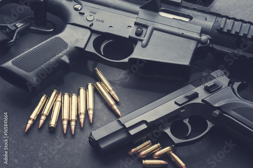 Valokuvatapetti Handgun with rifle and ammunition on dark background