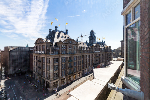 Exterior view of buildings at Damrak street in the old town part of Amsterdam Canvas Print