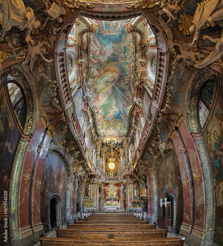 Vertical panorama of interior of Asamkirche in Munich, Germany