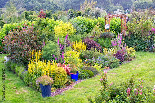 Very Colourful British Formal Garden With Mixed Border Of Flowers