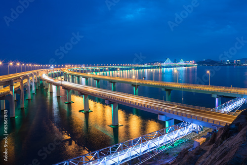 Fotografiet  Dalian Cross-Sea Bridge at night,China.