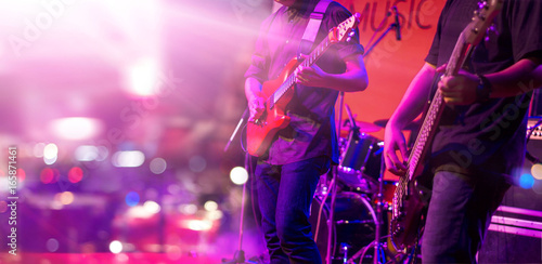 Guitarist and colorful lighting on stage, soft focus - 165871461