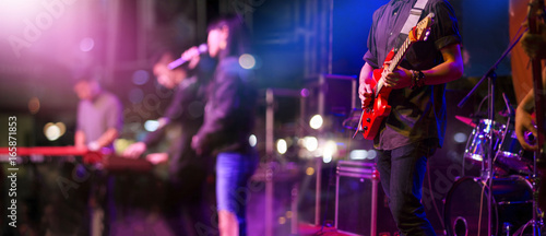 Fotografia Guitarist on stage for background, soft and blur concept