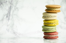 Colorful French Macaroons On A Marble Table