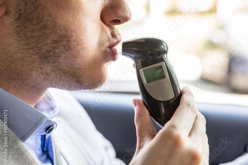 Poster de jardin Bar Man Sitting Inside Car Taking Alcohol Test