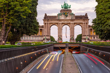 Dramatic View Of The Triumphal Arch And Belliard Tunnel In Park Cinquantenaire In Brussels During Sunset