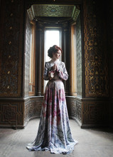 Beautiful Woman In Pink Dress Posing In Luxury Palace