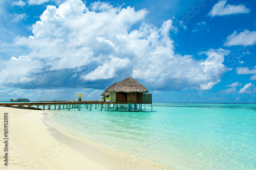 Poster Oceanië Wooden villas over water of the Indian Ocean, Maldives