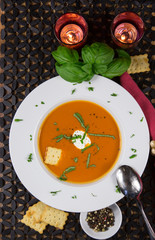 Fototapeta Tomato Soup Served in a Bowl with Basil and Sour Cream Garnish
