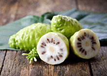 Noni Fruit On Wooden Background