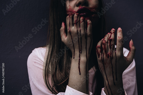 Zombie women death ghost standing with blood, darkness background, horror hallow Canvas Print