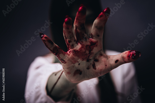 Photo  Zombie women death ghost standing with blood, darkness background, horror hallow