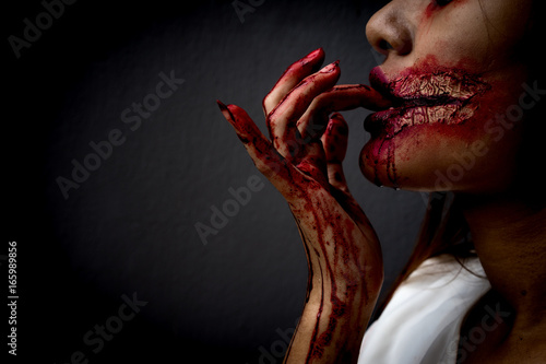Photo  Zombie women death ghost eating with blood, darkness background, horror hallowee