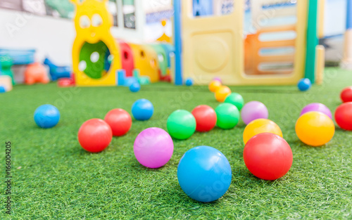 Photo colorful plastic ball on green turf at school playground