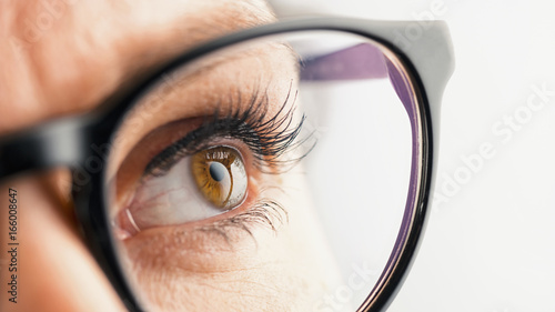 Thoughtful Female eye with glasses