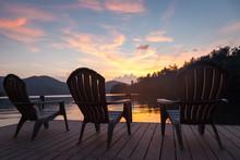 Sunset Chairs On Lake