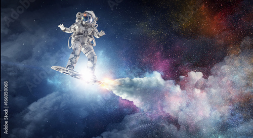 Photographie Spaceman on flying board. Mixed media