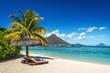 Leinwandbild Motiv Loungers and umbrella on tropical beach in Mauritius