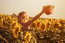 Happy Woman Enjoys In Beautiful Sunflower Field.