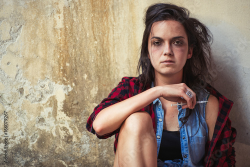 Dependence on drug heroin young woman after having pierced with syringe Canvas Print