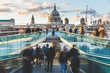 London and St Paul Cathedral with blurred people