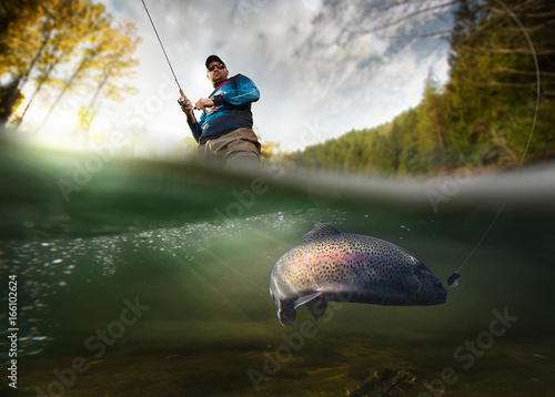 Stampa su Tela Fishing. Fisherman and trout, underwater view