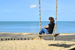 Relaxing on swing at the beach 2
