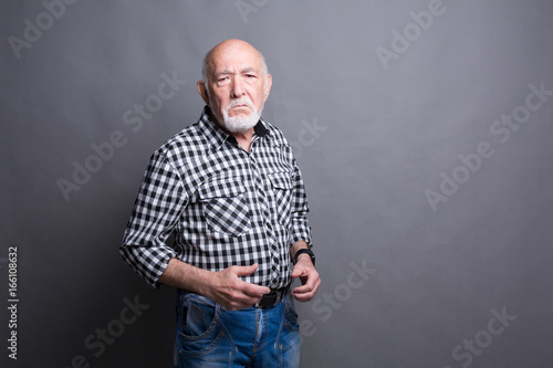 Angry senior man posing, copy space Canvas Print