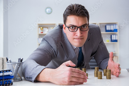 Fototapeta Businessman with golden coins in business growth concept