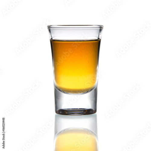 Poster Alcohol Cocktail Glass with brandy or whiskey - Small Shot. Isolated on white background