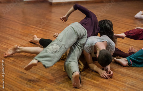 dancers contact, on floor