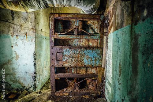 Photo  Old rusty steel armored door in abandoned soviet military bunker