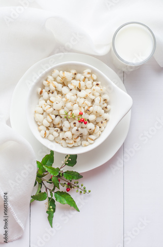 Fotografia, Obraz  Healthy breakfast with boiled job's tears porridge in white bowl on wooden table