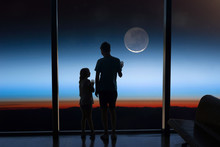 Children Look At The Moon Through The Window