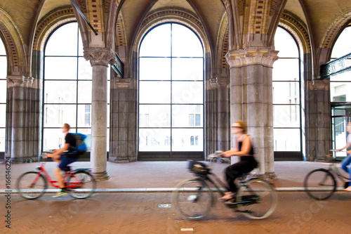 Photo  Moving cyclist along street in Amsterdam