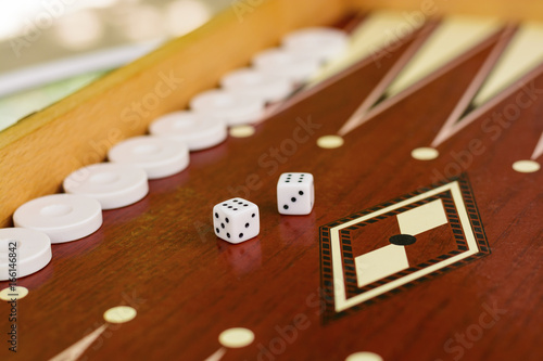 backgammon bone square white dice for gambling with blurred background плакат