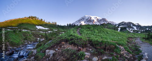 Fototapeta Mt. Rainier panorama at sunrise. Waterfall, paths and wildflowers in the foreground. Location: Mt. Rainier National Park in Washington state obraz