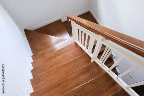 Poster Trappen wood staircase inside contemporary white modern house