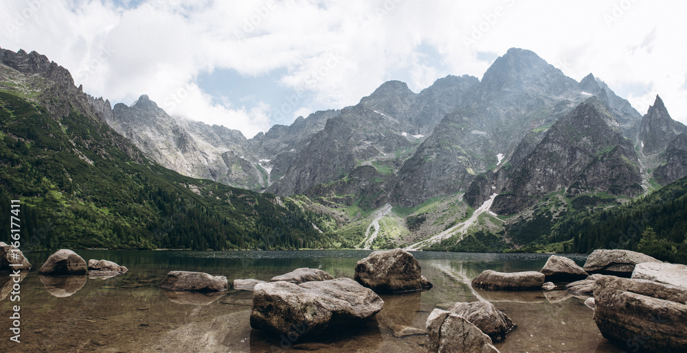 Fototapety, obrazy: Beautiful panoramic view of mountain lake Morskie oko with stones at foreground