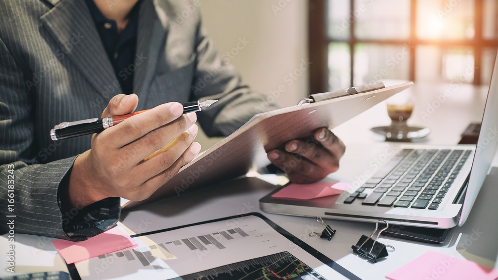 Fototapety, obrazy: Audit concept,Bookkeeper or financial inspector and secretary making report Financial Planning Report in Spreadsheet .Internal revenue Service inspector checking financial document vintage tone.